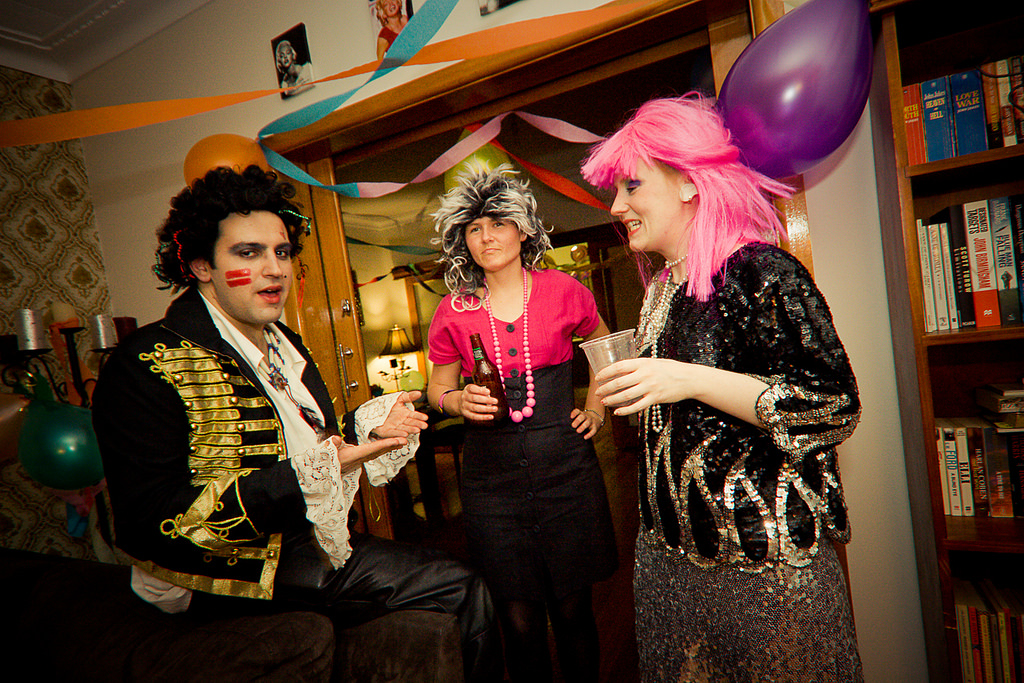 Employees dressed up as Prince at office birthday party